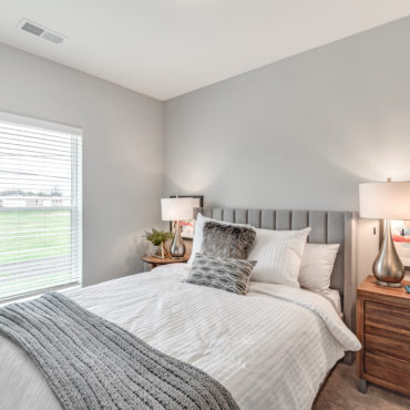 bedroom in The Jacqueline apartments in Olde Towne East