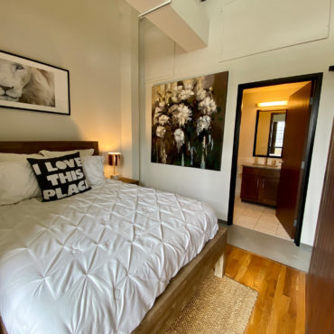 Bed in in One Bedroom Apartment Downtown at The Julian