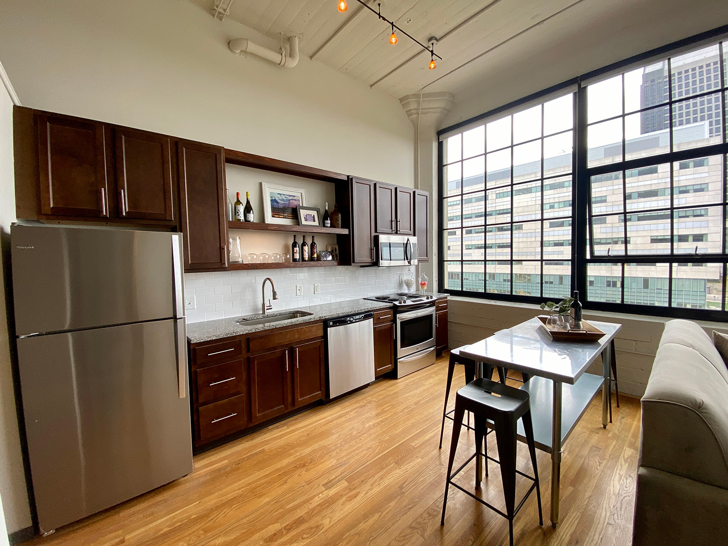 Kitchen and dining in One Bedroom Apartment Downtown at The Julian